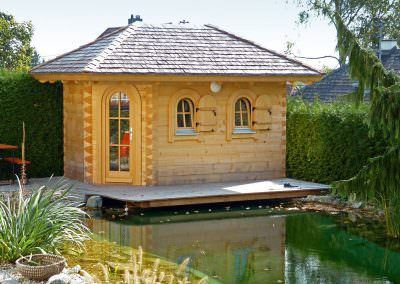 Garden Sauna Made of Square Block Planks, Covered with Hand-Chopped Larch Shingles