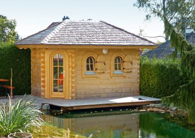 Garden Sauna Made of Square Logs, Covered with Wooden Shingles